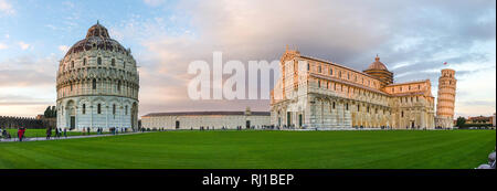 sky sunset panorama of Pisa Cathedral (Duomo di Pisa) with Leaning Tower (Torre di Pisa) and Baptistery of St. John (Battistero di Pisa) in Italy - Stock Photo
