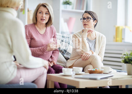 Women Discussing Problems - Stock Photo