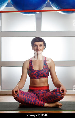 "yoga woman meditation an easy seat ""sukhasana"" hand"