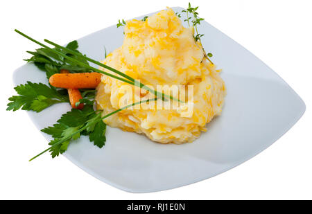 Traditional Scottish dish Clapshot -  mashing of turnips and potatoes. Served with vegetables and herbs. Isolated over white background - Stock Photo