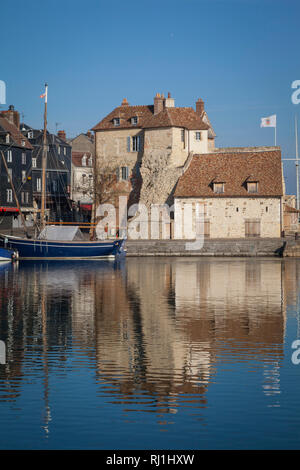 The Honfleur flag flies on La Lieutenance, situated on the harbour or Vieux Bassin at Honfleur, France. - Stock Photo