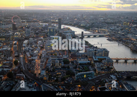 Aerial view of London Skyline and River Thames Cityscape viewed from the Shard at night. - Stock Photo