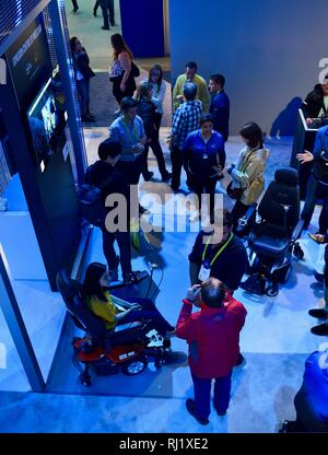 Attendees trying out demos of computers, augmented reality experience with Magic Leap One, video games, 5G at Intel booth at CES, Las Vegas, USA. - Stock Photo