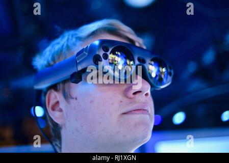 Using Magic Leap One mixed reality goggle for Mimesys debut of holographic collaboration as 2 people build drone at Intel booth at CES, Las Vegas, USA - Stock Photo