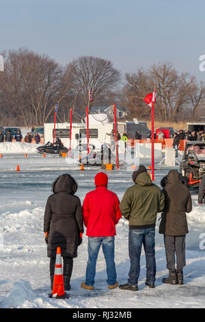 Fair Haven, Michigan - Snowmobile drag racing on Anchor Bay of frozen Lake St. Clair. - Stock Photo