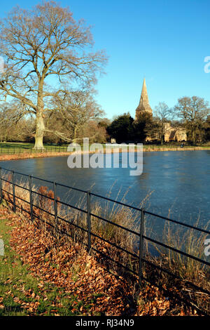A frozen moat in the grounds at Broughton Castle near Banbury, Oxfordshire - Stock Photo