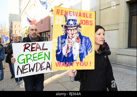 Demonstrators seen holding placards during the protest. 350.org, Food & Water Watch and other groups organized a protest to encourage U.S. Representative Hakeem Jeffries (D-NY) to support the Green New Deal. Protest was held in front of the Hanson Place office building in Brooklyn, NY. - Stock Photo