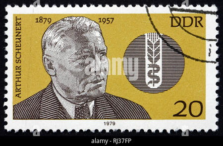 GERMANY - CIRCA 1979: a stamp printed in Germany shows Carl Arthur Scheunert, German Veterinary, and Symbol of Nutrition and Health, circa 1979 - Stock Photo