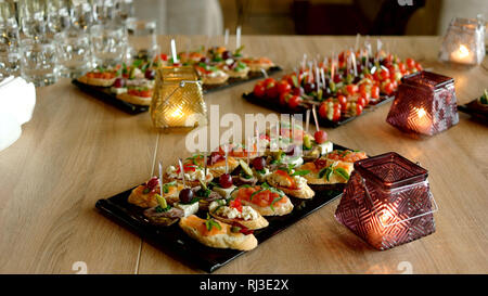 Delicious appetizers at served table in restaurant. - Stock Photo