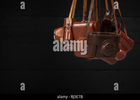 Drohobych, Ukraine - 03 February, 2019: Old-fashioned analog 35mm cameras Fed 2 and Fed 5, Zorki C and Zorki 4, in brown leather covers. Collectibles