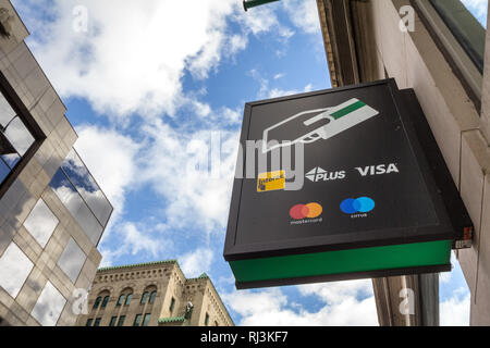 MONTREAL, CANADA - NOVEMBER 7, 2018: Sign on an ATM with the logos indicating the credit and debit pay cards accepted, that include Visa, mastercard,