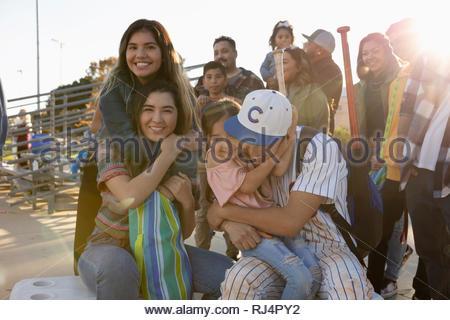 Portrait happy Latinx baseball player and family - Stock Photo