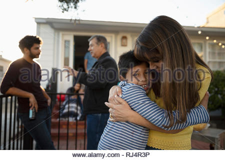 Affectionate Latinx grandmother and grandson hugging - Stock Photo
