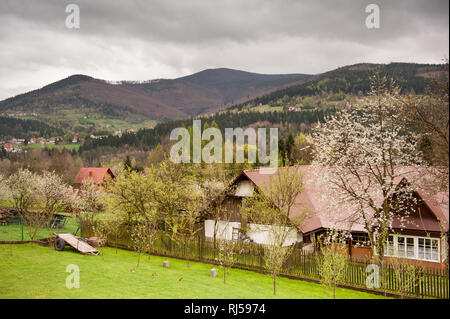 Babia Gora massif view afar from Zawoja village, highlands landscape in Poland, Europe, backyard and houses in valley in cloudy gloomy weather, nobody - Stock Photo