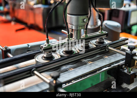 Canned can production line in factory line conveyor machine. - Stock Photo
