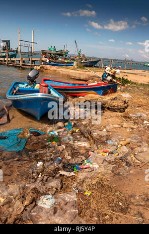 Cambodia, Preah Koh Kong, Prek Kaoh Pao river fishing boats on messy shore littered with plastic - Stock Photo