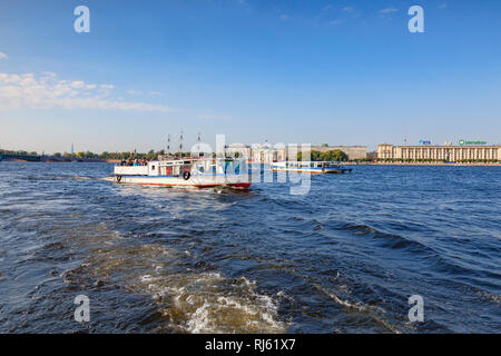 19 September 2018: St Petersburg, Russia - Tourist boats on the River Neva, on a bright and sunny autumn day. - Stock Photo