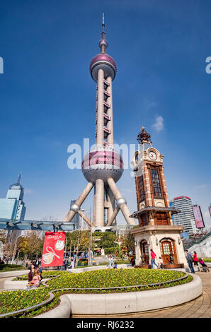 1 December 2018: Shanghai, China - Oriental Pearl Tower and Disney Store clock tower in the Pudong districtof Shanghai. - Stock Photo