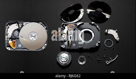 Computer hard disc before and after it is rendered safe from data theft. - Stock Photo
