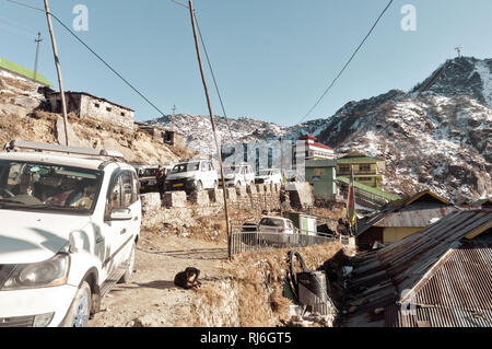 Tsomgo Lake, Gangtok, India 2 Jan, 2019: Tourist cars lined up near rope way building. A short ropeway has started at Tsomgo lake. It takes to a hill  - Stock Photo