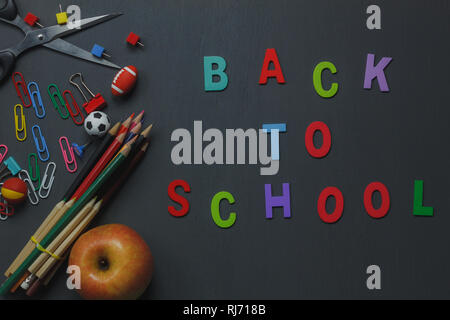 Top view Back to school or education background with decoration.stationary is colorful pencil,clip paper,scissor,apple,football,basketball,baseball an - Stock Photo