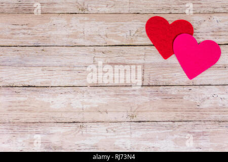 White Saint Valentine's day background with red and pink hearts, copy space. Symbol of love, Love concept, top view, flat lay - Stock Photo