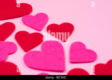 White Saint Valentine's day background with red and pink hearts, blurred focus, close-up view, copy space. Symbol of love, Love concept. - Stock Photo