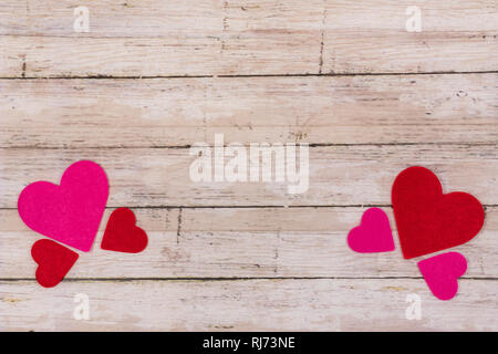 White wooden Saint Valentine's day background with red and pink hearts, copy space. Symbol of love, Love concept, top view, flat lay - Stock Photo