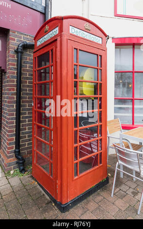 Public Access Defibrillator machine in an old red telephone box in Storrington, West Sussex, England, UK. - Stock Photo