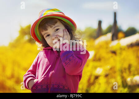 Child in a hat in rural style. Selective focus. - Stock Photo