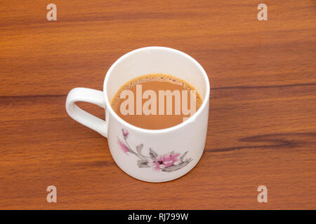 Masala indian Tea Chai hot in a white cup on a wooden background, Cup of tea - Stock Photo
