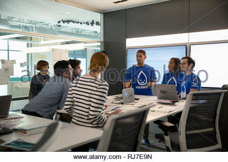Millennial entrepreneurs strategizing in conference room - Stock Photo