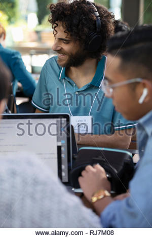 Computer programmers with virtual reality simulator working - Stock Photo
