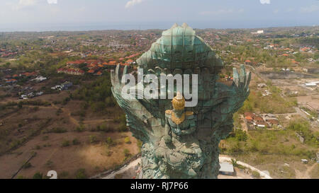 Aerial view statue hindu god garuda wisnu kencana Statue, Bali. Statue at entrance Garuda Wisnu Kencana Cultural Park. - Stock Photo