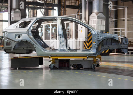 Russia, Izhevsk - December 15, 2018: LADA Automobile Plant Izhevsk, part of the AVTOVAZ Group. Car frame structure on automobile. - Stock Photo