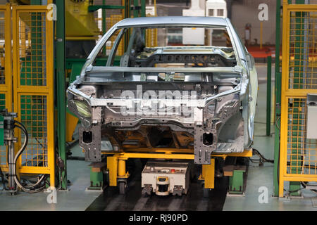 Russia, Izhevsk - December 15, 2018: LADA Automobile Plant Izhevsk. Frame construction of the car in the welding shop of the automobile plant. - Stock Photo
