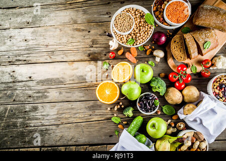 Healthy food. Selection of good carbohydrate sources, high fiber rich food. Low glycemic index diet. Fresh vegetables, fruits, cereals, legumes, nuts, - Stock Photo