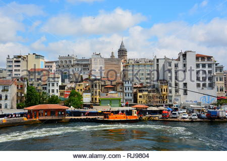 Turkey Istanbul Fish market and Pier below Galata Tower on the Golden Horn - Stock Photo