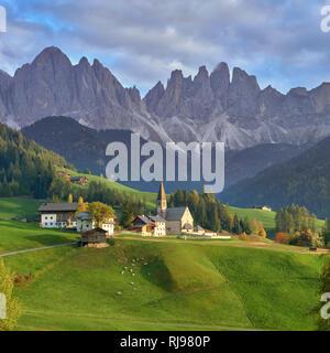 Autumn view of Santa Maddalena or St Magdalena Church, Val di Funes, Dolomites, South Tyrol, Italy - Stock Photo