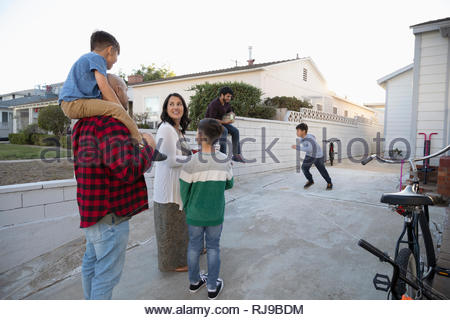 Latinx family in driveway - Stock Photo