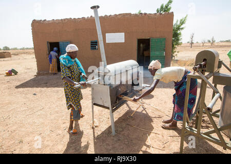 Yarsi village, Yako, 1st December 2016;  Members of the Village Tree Enterprise Shea Group heat crushed shea nuts as part of the process of producing shea butter. - Stock Photo