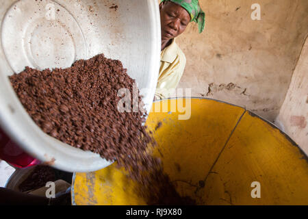 Yarsi village, Yako, 1st December 2016;  Members of the Village Tree Enterprise Shea Group with crushed shea nuts, a part of the process of producing shea butter. - Stock Photo