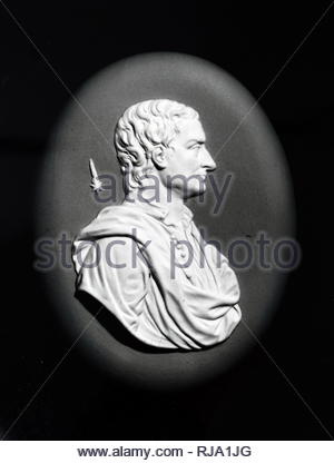 Wedgewood medallion of Isaac Newton on blue Jaspar Ware. Isaac Newton (1643-1727) an English mathematician, astronomer, theologian and physicist. Dated 18th century - Stock Photo