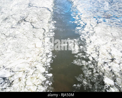 trace of ship in ice of frozen Moskva river in winter - Stock Photo