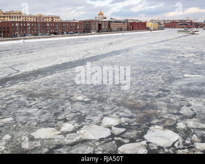frozen Moskva River near Prechistenskaya embankment and view of Cathedral of Christ the saviour in Moscow city - Stock Photo