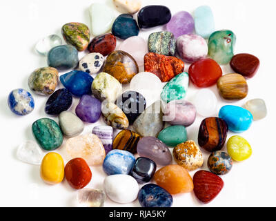 above view of many various gemstones on white board - Stock Photo