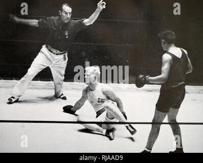 Photograph of David Daniel Carstens (1914 - 1955) from South Africa fighting Peter Oscar Jørgensen (1907 - 1992) from Denmark at the 1932 Olympic games. David Daniel Carstens takes gold in the Light Heavyweight division. - Stock Photo