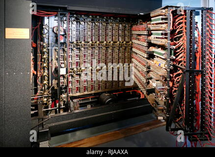 Rear view of the rebuilt Bombe at Bletchley Park. This shows the patch panels and 26-way cables used to wire up the 'menus'. It includes the 'diagonal boards' which, despite their name, are physically rectangular. The bombe was an electro-mechanical device used by British cryptologists to help decipher German Enigma-machine-encrypted secret messages during World War II. The initial design of the bombe was produced in 1939 at the UK Government Code and Cypher School (GC&CS) at Bletchley Park by Alan Turing, with an important refinement devised in 1940 by Gordon Welchman - Stock Photo