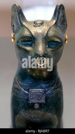 The Gayer-Anderson Cat is an Ancient Egyptian statue of a cat, which dates from the Late Period (around 664–332 BC). It is made of bronze, with gold ornaments. The sculpture is known as the Gayer-Anderson cat after Major Robert Grenville Gayer-Anderson. The cat wears jewellery and a protective wadjet amulet. A scarab appears on the head and a winged scarab is shown on the chest. - Stock Photo