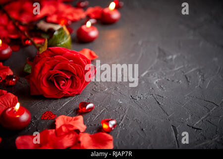 Red rose, petals, candles, dating accessories, boxed gifts, hearts, sequins - Stock Photo